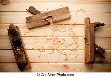 joiner tools on wood table background with Woodchips -...