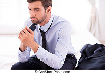 Lost in business thoughts Thoughtful young man in shirt and...