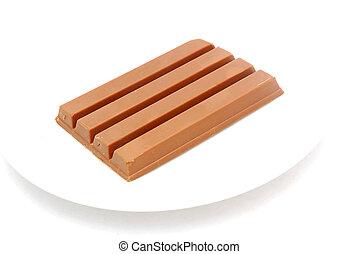 Chocolate bar - A big brown chocolate bar on a plate...
