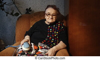 Lonely grandmother waiting for a phone call at home -...