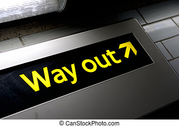 Way out - grungy way out sign from a subway in london lit by...