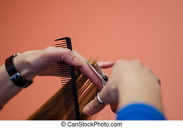close up of hairdresser hand cut hair woman - close up of...