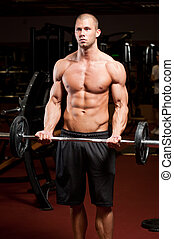 Fitness strength. - Portrait of an attractive athletic young...
