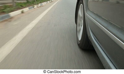 Car speeding down the highway along dividing line
