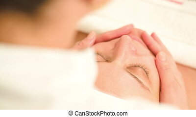 Facial procedure at beauty treatment salon