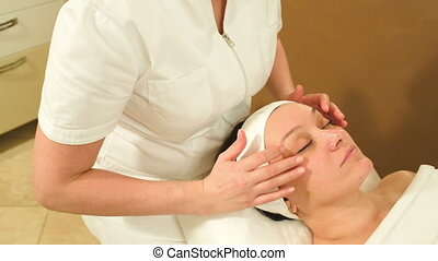 Facial massage with accent on eye area - Tilt and dolly shot...