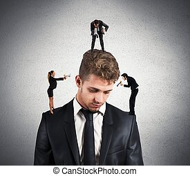 Stress - Concept of stressed man due to colleagues