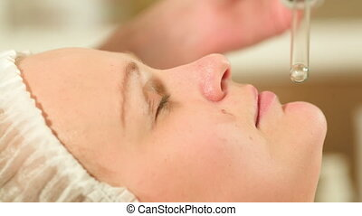 Facial procedure at beauty spa with laser using - Close-up...