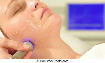 Woman taking lifting treatment at beauty spa - Close-up shot...