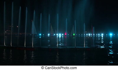 Holiday light show and sailing yachts in water area of Yalta...