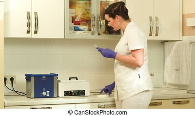 Female beautician starting sterilization of cosmetological...