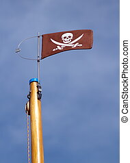 Jolly Roger skull and crossbones pirate flag upon a wood...