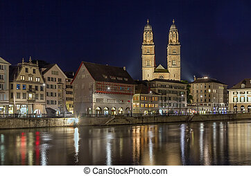 Grossmunster church, Zurich - Evening. View of Limmat river...