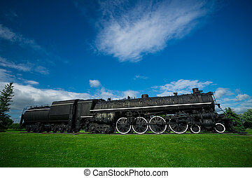 Old, Antique Steam Train Engine - A large, black, iron...