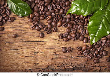 Coffee beans and green leaves