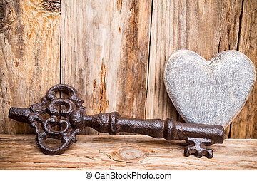 Key - Old vintage key with heart on wooden background