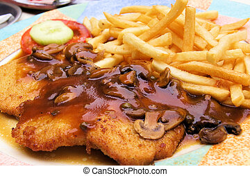 Weiner schnitzel - Plate of traditional schnitzel with...