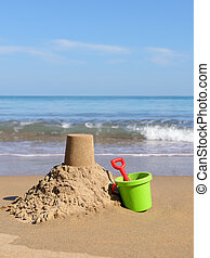 Beach holiday - beach holiday sand castle by the sea hot...