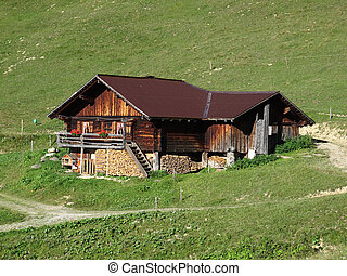 Traditional old farm house in the Bernese Oberland, Swiss...