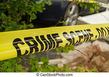 Crime Scene tape - Yellow tape barrier surrounding a crime...