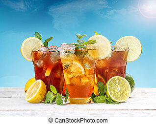 Ice tea - Fresh and cold ice tea with sliced lemon and mint