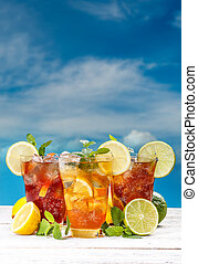 Summer iced tea with lemon, lime and mint