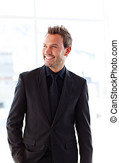 Smiling handsome businessman in office - Isolated smiling...