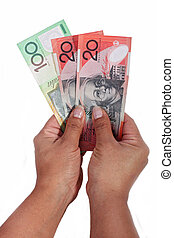 dollar notes against white background - Girl holding dollar...
