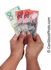 dollar notes against white background - Girl holding dollar...