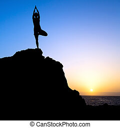 Woman exercise yoga tree sunset silhouette - Young woman...