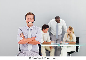 Young and handsome businessman with a headset on