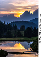 Beautiful colorful sunset with reflections in the lake