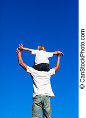 Son sitting on his fathers shoulders