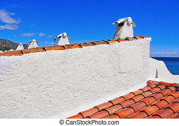 mediterranean architecture - view of a tiled roof of a...