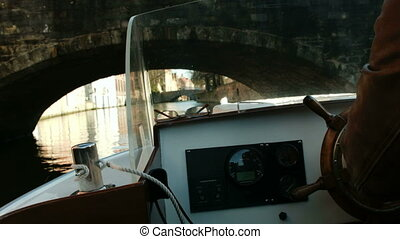 Shot from a boat Helm of boat Bruges, Belgium - Shot from a...
