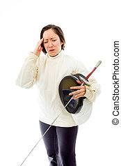 Female fencer suffering from headache