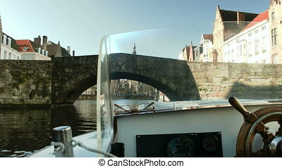 Shot from a boat. Helm of boat. Bruges, Belgium. - Shot from...