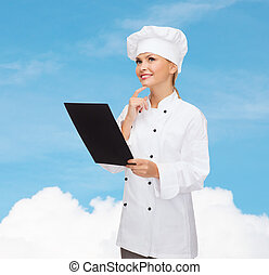 smiling female chef with black blank paper - cooking,...