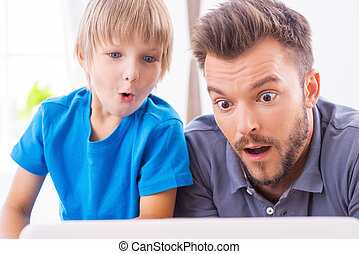 That is unbelievable! Surprised father and son looking at...