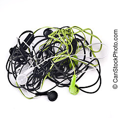 Twisted headphones, of different colors, on white background...