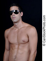 sun glasses - naked muscular male model with sun glasses