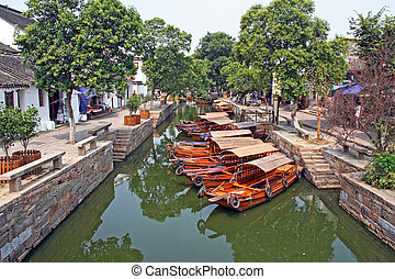 Landscape of Tongli watertown with traditional boats and old...
