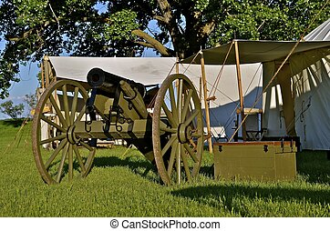 Cannon Resides Near Officer Tents - A cannon and ammunition...