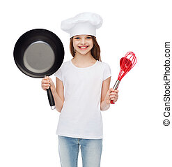 smiling girl in cook hat with ladle, whisk and pan