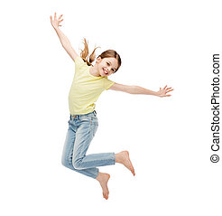smiling little girl jumping - happiness, activity and child...
