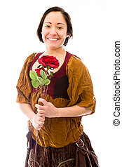 Young woman smiling with holding red rose