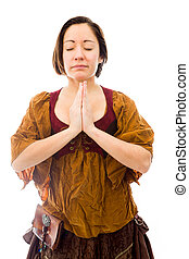 Young woman standing in prayer position