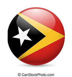 Round glossy icon of East Timor - Flag of East Timor as...