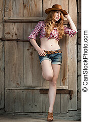red haired cowgirl - outdoors portrait of beautiful red...