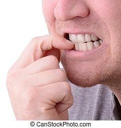 Nail biting - a macro view of biting nails